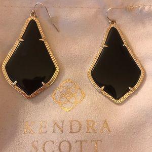 Kendra Scott Alex earnings. Black and gold.